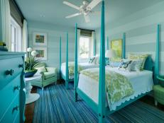 Aqua Bedroom With Twin Poster Beds and Striped Walls