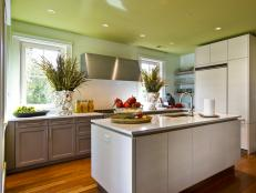 Soft Green Kitchen With Modern Island