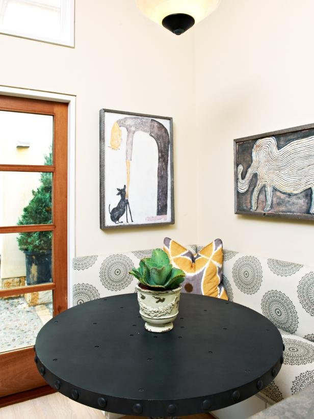 Breakfast Nook With Upholstered Banquette and Eclectic Art