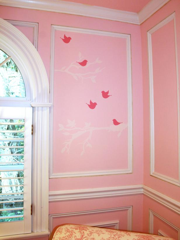 Traditional Pink Baby's Room With White Accents