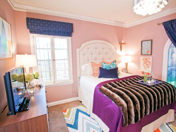 Eclectic Bedroom with Pink Walls and Dark Blue and Orange Accents