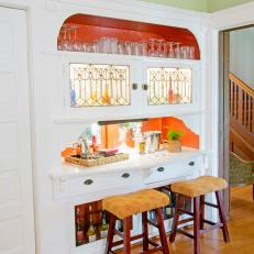 Contemporary Bar With Orange Shelving for Glasses