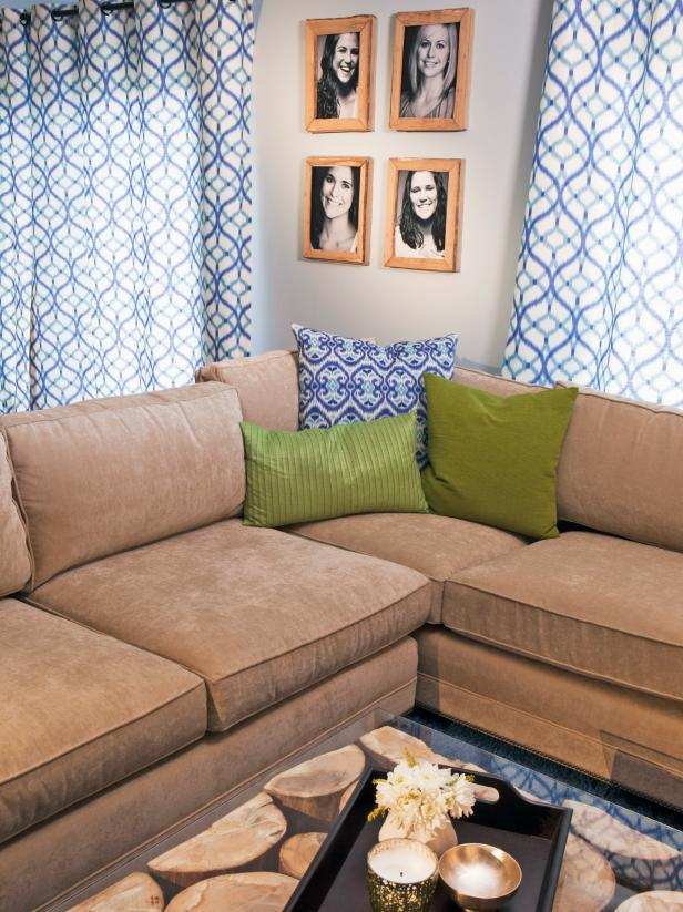 Tan Sectional With Rustic Coffee Table, Blue & White Curtains