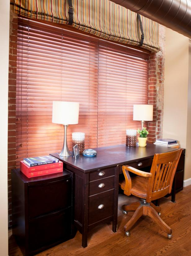 Eclectic Home Office with Exposed Brick