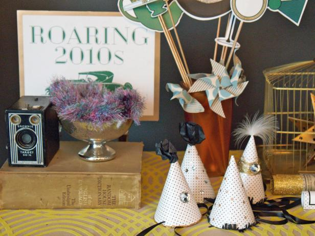 Set up a table displaying props where guests can pick up accessories on their way into the photo booth. A variety of props keeps things fun and guests interested.
