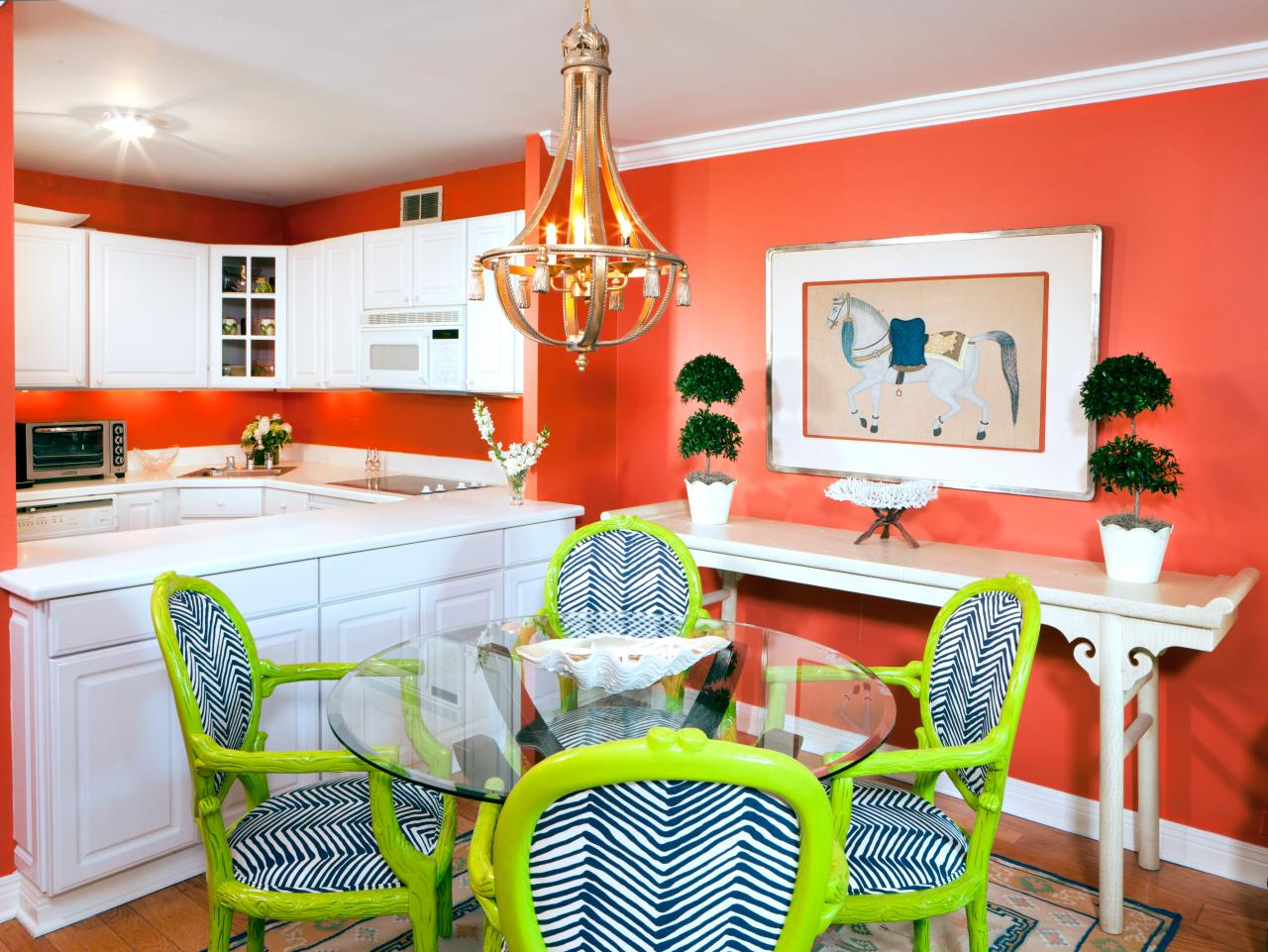 coral dining room and kitchen with white cabinets the kitchen and