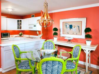 Coral Dining Room and Kitchen With White Cabinets