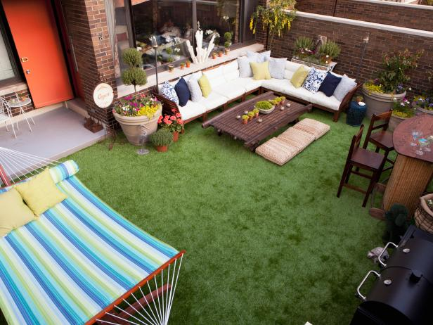 Outdoor Patio With Synthetic Grass Floor, White Sectional and Hammock