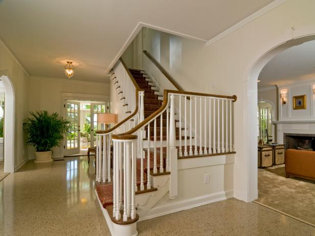 Neutral Foyer With Staircase and Terrazzo Floors