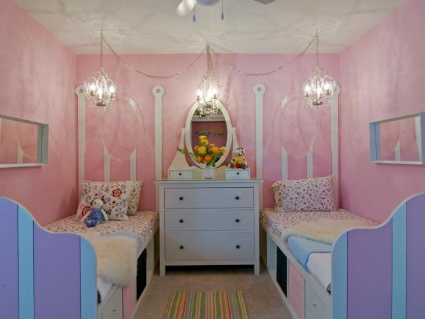 Pastel Pink Feminine Bedroom With Chandeliers and Striped Twin Beds