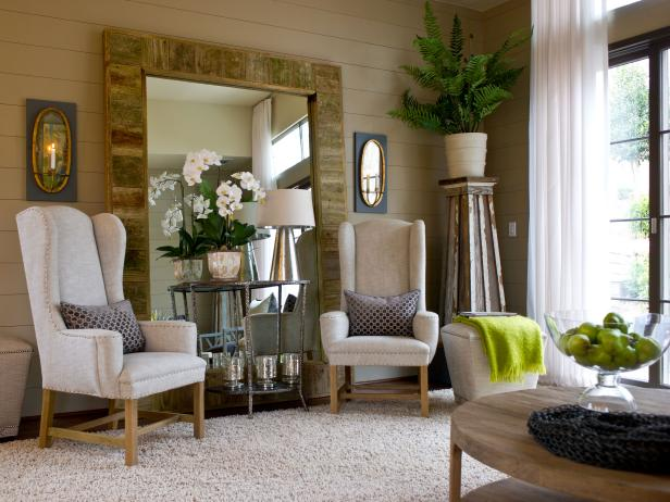 Neutral Living Room With Two Upholstered Chairs and Large Wood Mirror
