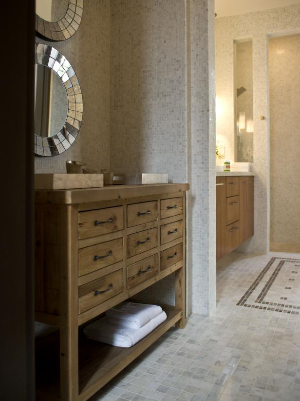 Neutral Bathroom Nook With Rustic Wood Dresser and Sunburst Mirrors