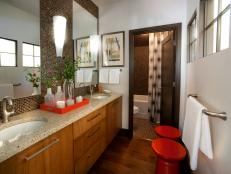 Modern Bath in Neutral and Warm Wood Tones with Red Accents