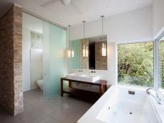 Frosted Glass Divider Provides Privacy in Open Bathroom