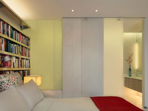 Soft Green Bedroom With Translucent Walls and Bookshelves
