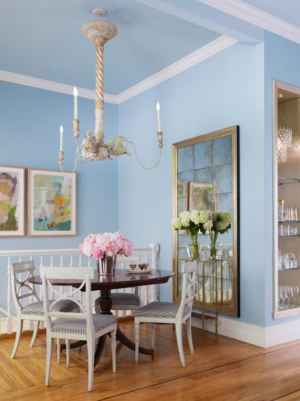 Light Blue Dining Room With Vintage Chandelier and Antiqued Mirror