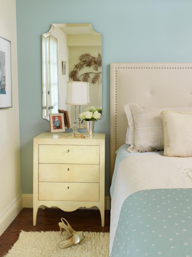 Traditional Master Bedroom With Neutral Headboard and Nightstand