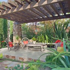 Concrete Patio With Rustic Pergola