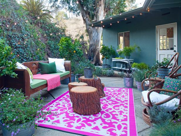 Graphic Pink Rug on Outdoor Patio With Tree Stumps, Wooden Bench