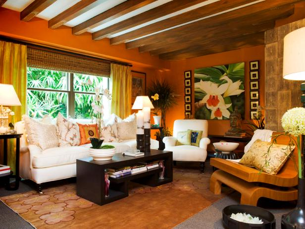 Tropical Orange Living Room With Beamed Ceiling