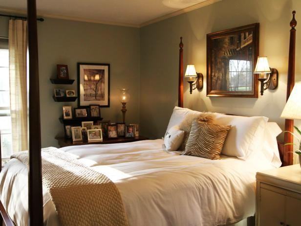 Traditional Bedroom With Framed Photos and Wood Poster Bed