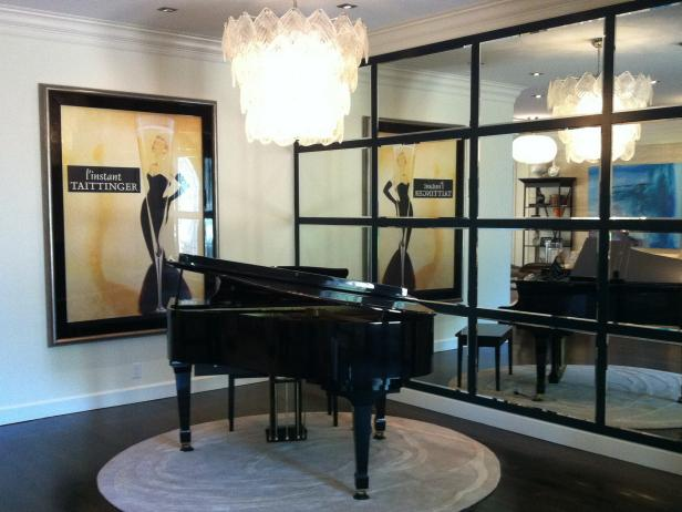 Black Grand Piano under Crystal Chandelier With Tile Mirrored Wall