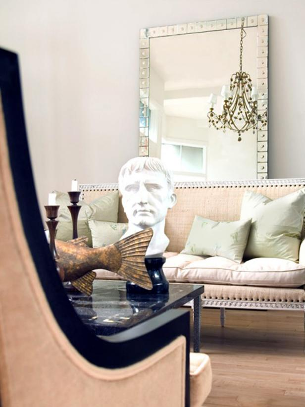 Neutral Living Room With Oversize Mirror and Sculptures