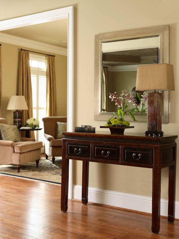 Classic Entryway With Traditional Table and Mirror