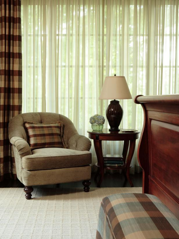 Beige Chair in Front of Green Curtains