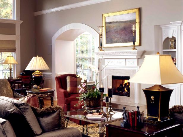 Traditional Living Room With Marble Fireplace and Arched Doorway