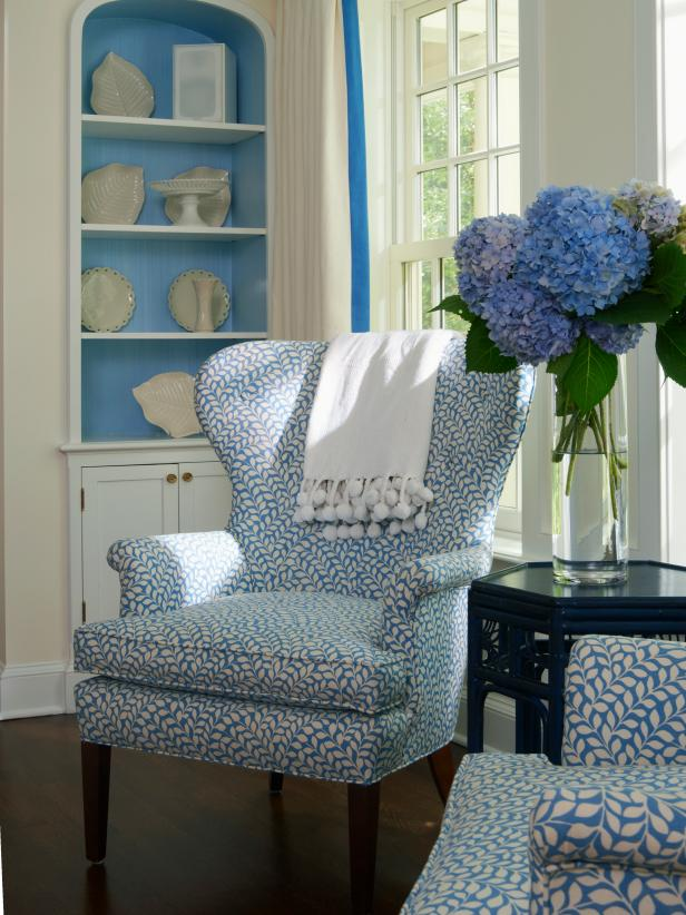 Blue and White Wingback Chair with Patterned Upholstery