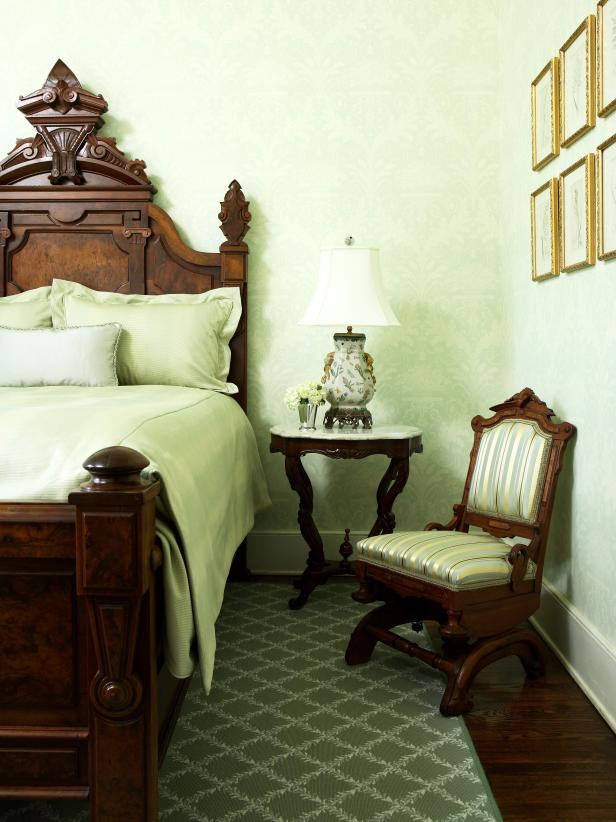 Green Bedroom With Carved Wood Headboard