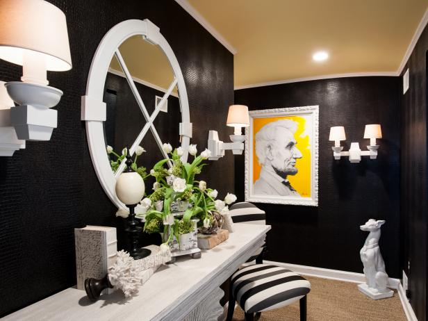Entryway With Black Walls, White Console Table and Abraham Lincoln Art