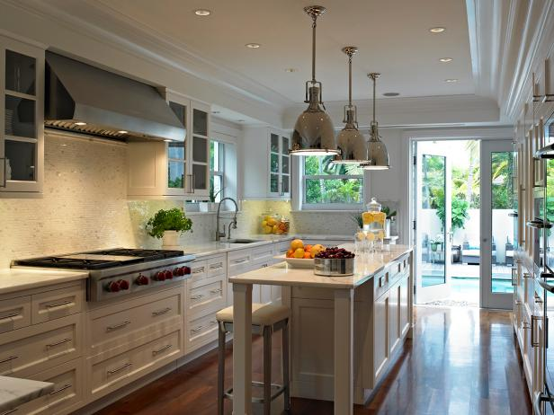 Long Kitchen With Industrial Pendants and Mosaic Backsplash