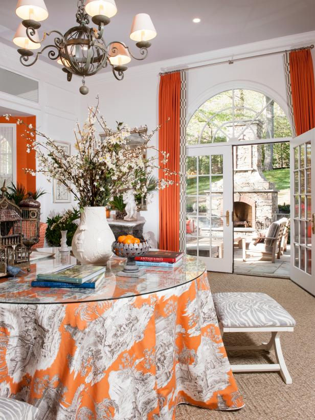 Dining Area With Orange Curtains