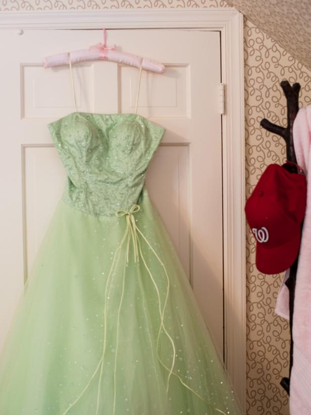 Prom Dress Hangs in Girl's Pink Bedroom