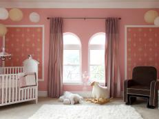 Pink Girl's Nursery With Brown Chair