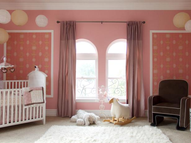 Pink Girl's Nursery With Brown Chair and White Shag Rug