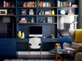 Contemporary Home Office With Navy Bookshelves And Yellow Accents