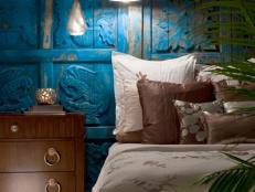 Dramatic Blue Headboard in Eclectic Bedroom