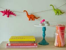 Neon Dinosaur Garland Decorates and Accents Wall in Kid's Room