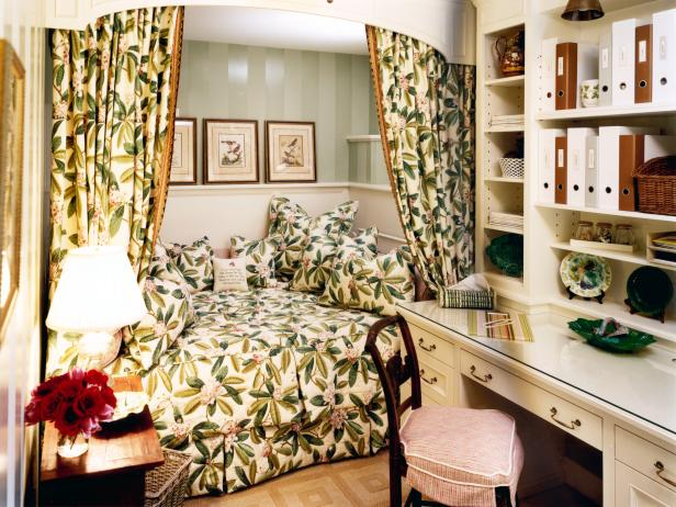 Green Bedroom Nook With Floral Curtains and White Desk With Shelving