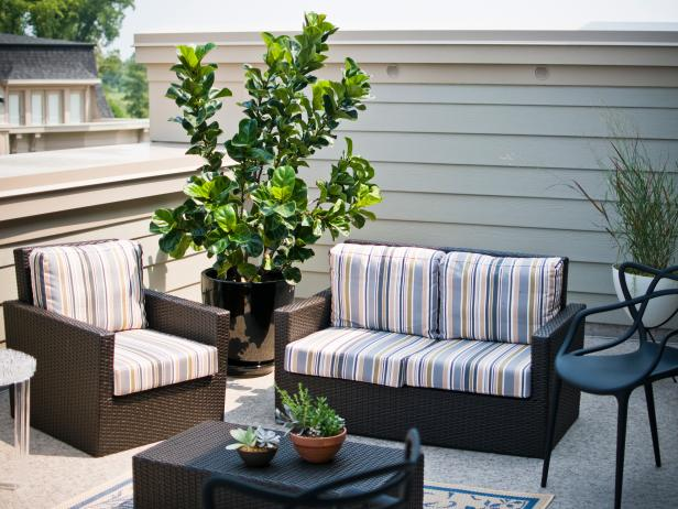 Roof Deck With Streamlined Wicker Furniture and Green Plants
