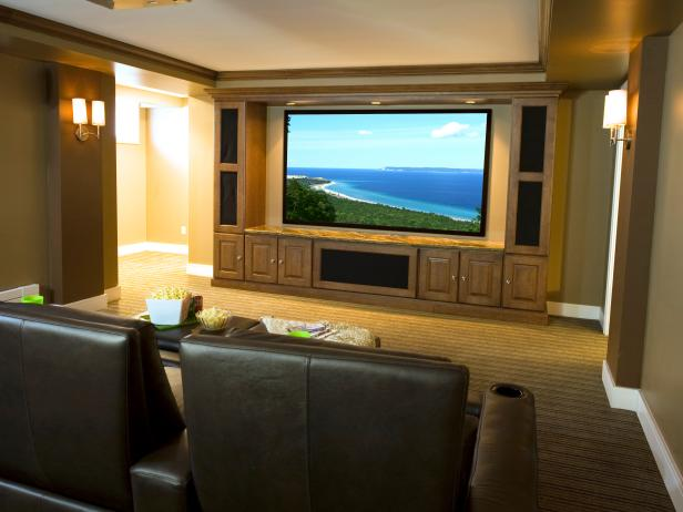 Home Theater With Large TV Screen and Brown Seats