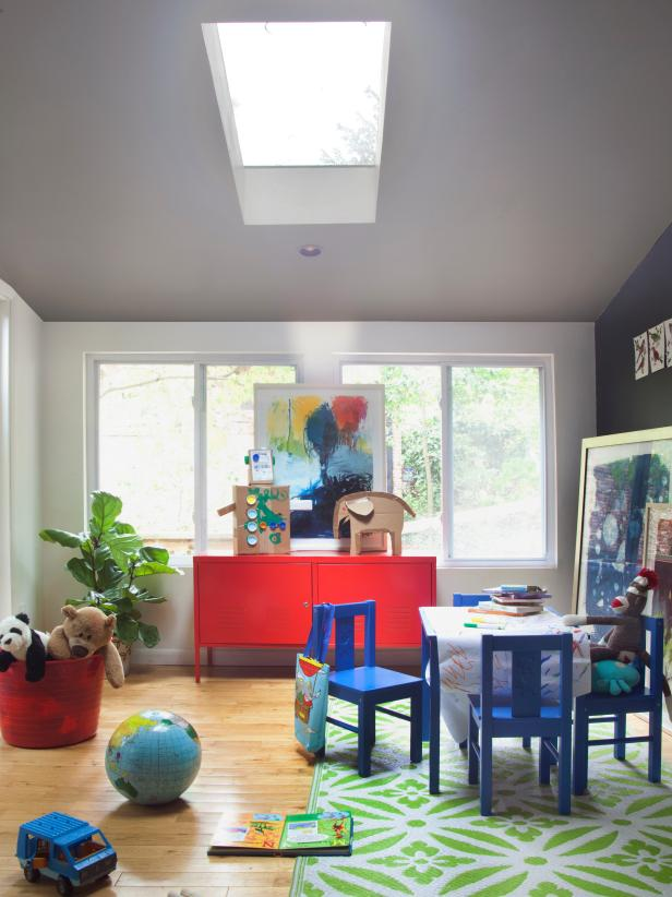 Eclectic Playroom With Green Area Rug
