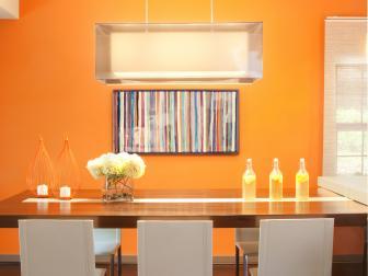 Bright Orange Dining Room With Modern Pendant Light