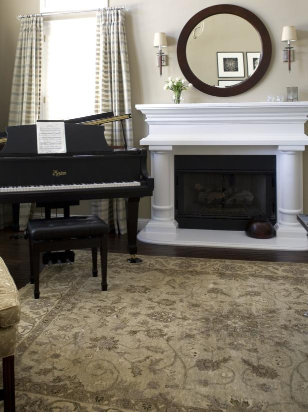 Neutral traditional living room with fireplace and piano