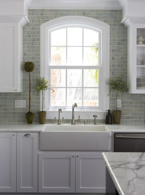 Green Kitchen With White Cabinetry and Subway-Tile Backsplash