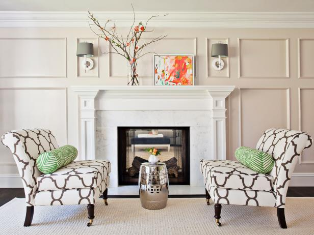 White Sitting Room With Slipper Chairs In Front of Fireplace