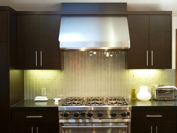 Sleek Kitchen With Stainless Steel Stove and Dark Brown Cabinets